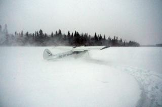 The plane lands in snow