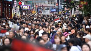 Protesters gather to attend a new rally against a controversial extradition law proposal in Hong Kong on June 16, 2019