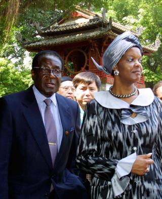 Visiting Zimbabwean President Robert Mugabe and his wife Grace tour the Temple of Litterature in Hanoi, 2001