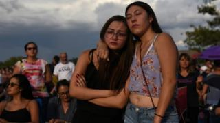 Amber Ruiz and Jazmyn Blake embrace during a vigil a day after a mass shooting at a Walmart store in El Paso