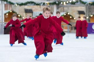 in_pictures Choristers of Winchester Cathedral skate on the cathedral's ice rink