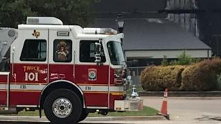 A fire engine near the scene of a plane crash in Texas, US