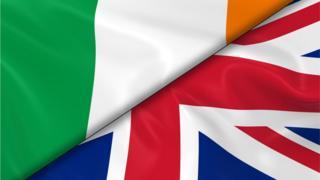 Irish flag and British flag