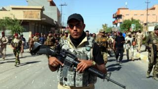 Members of the Hashd al Shaabi patrol in Kirkuk