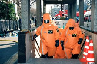 Tokyo Fire Department Haz-Mat team leave after decontamination work at Kasumigaseki Station