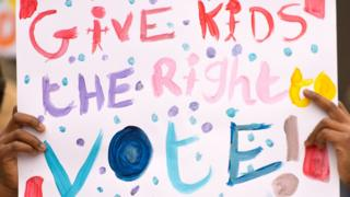 Give kids the right to vote placard