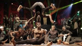 In Zimbabwe, a group of acrobats perform for a captive audience during the annual Harare International Festival of the Arts (Hifa) on 1 May 2018