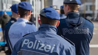Police officers stand outside in Zurich