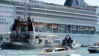 The cruise ship MSC Opera loses control and crashes against a smaller tourist boat at the San Basilio dock in Venice