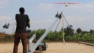 Technician dey operate drone