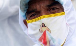Man in Jesus face mask