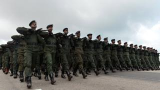 Sri Lankan army soldiers march during a victory parade rehearsal in Colombo in 2013