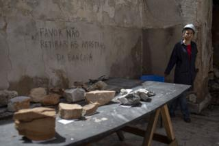 A worker guards artefacts found among the debris inside Brazil's National Museum