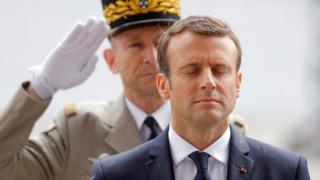 Emmanuel Macron observes a minute of silence during a wreath laying ceremony at the Arc de Triomphe in Paris on May 14, 2017