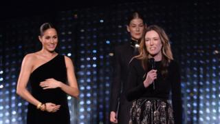 Clare Waight Keller with the Duchess of Sussex and Rosamund Pike