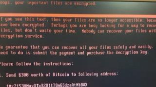 Mətndə deyilir ki, kompüterin diski şifrələndiyi üçün ona giriş bloklanıb.