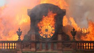 Flames destroy the clock at the top of Bank Buildings in Belfast