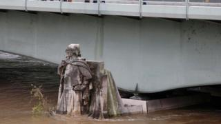 The Zouave statue submerged in rising water