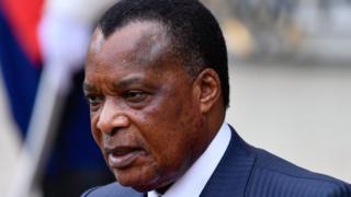 Paulin Makaya a été arrêté à la suite de manifestations contre la candidature Denis Sassou Nguesso (en photo) à un nouveau mandat.
