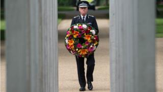 Metropolitan Police Commissioner Sir Bernard Hogan-Howe lays a wreath at the memorial in Hyde Park to mark the 11th anniversary of the 7/7 terrorist attacks on London