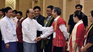 President Thein Sein, centre left in front, shakes hands with a representative of armed ethnic groups during a Nationwide Ceasefire Agreement meeting in Naypyidaw, Myanmar, in September 2015