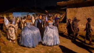 """Afro-Colombian children in costumes take part in the """"Adoraciones al Nino Dios"""" celebrations in Quinamayo, department of Valle del Cauca, Colombia, on February 18, 2018."""