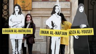 Amnesty International urges Saudi authorities to release activists Loujain al-Hathloul, Eman al-Nafjan and Aziza al-Yousef, outside the Saudi Arabian embassy in Paris, March 8, 2019