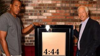 Jay-Z receives his platinum award from the RIAA
