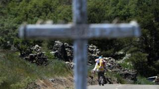 A pilgrim walks alone on the Way of Saint James near the village of Manjarin, between Astorga and Ponferrada, on May 29, 2015.