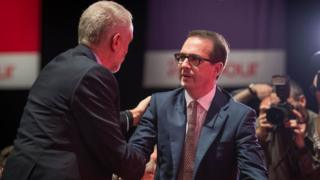 Owen Smith congratulates Jeremy Corbyn after the election result was announced