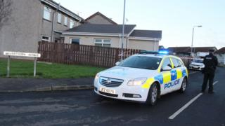 Police at the scene of the man's death in Silverthorn Avenue