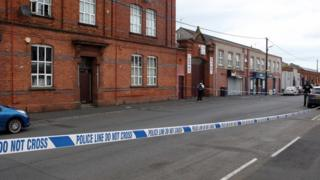 Scene of murder on Victoria Street in Lurgan, police officers present and area cordoned off