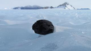 meteorite sitting on ice in Antarctica