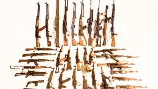 Several dozen military-style weapons discovered in a single search