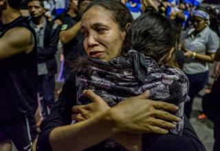 A mother and daughter hug after one of the daughter's classmates, 15-year-old Álvaro Conrado, died after being hit by a police bullet in the neck hen he delivered water to protesting students in Managua in April 2018.