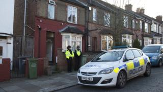 Police outside a house in Luton