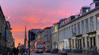 A sunset over Bath Street in Glasgow