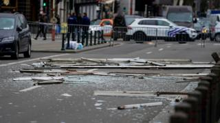 in_pictures Debris is spread across a road near a partially collapsed building in Brussels, 9 February 2020