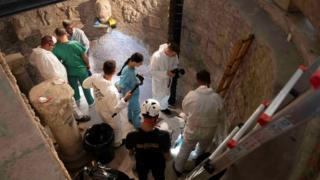 Experts open the trapdoor in the Teutonic Cemetery in the latest search