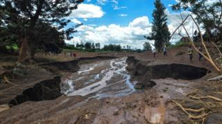 The destroyed area is seen after the bank of the private Patel dam, used for irrigation and fish farming, burst in Solai, about 40km north of Nakuru, Kenya