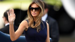 US First Lady Melania Trump pictured wearing sunglasses and waving