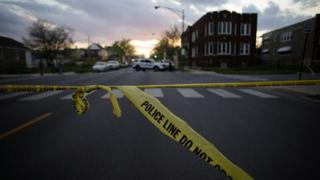 An image of police tape on a Chicago street