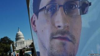 Image of Edward Snowden on a banner