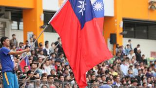 A Fan of Chinese Taipei holds a national flag