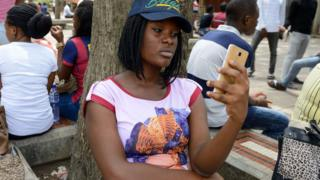 University student for Lagos sidon hold phone