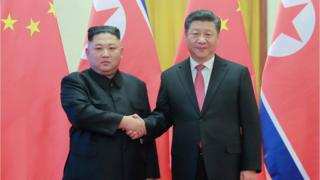 This file photo taken on January 8, 2019 and released on January 10 by North Korea's official Korean Central News Agency (KCNA) shows North Korea's visiting leader Kim Jong Un (L) shaking hands with China's President Xi Jinping (R) during a welcome ceremony at the Great Hall of the People in Beijing