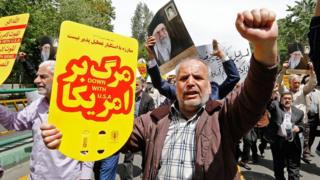 Iranian protesters chant anti-US slogans during a rally in the capital Tehran on 10 May 2019