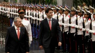 Canada's Prime Minister Justin Trudeau (R) and Cuban President Raul Castro (L) review the guard of honour during a ceremony at Revolution Palace on November 15, 2016.