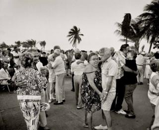 Elderly couples dance together on Miami Beach