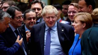 Boris Johnson was surrounded by EU leaders after the deal was announced at the Brussels summit